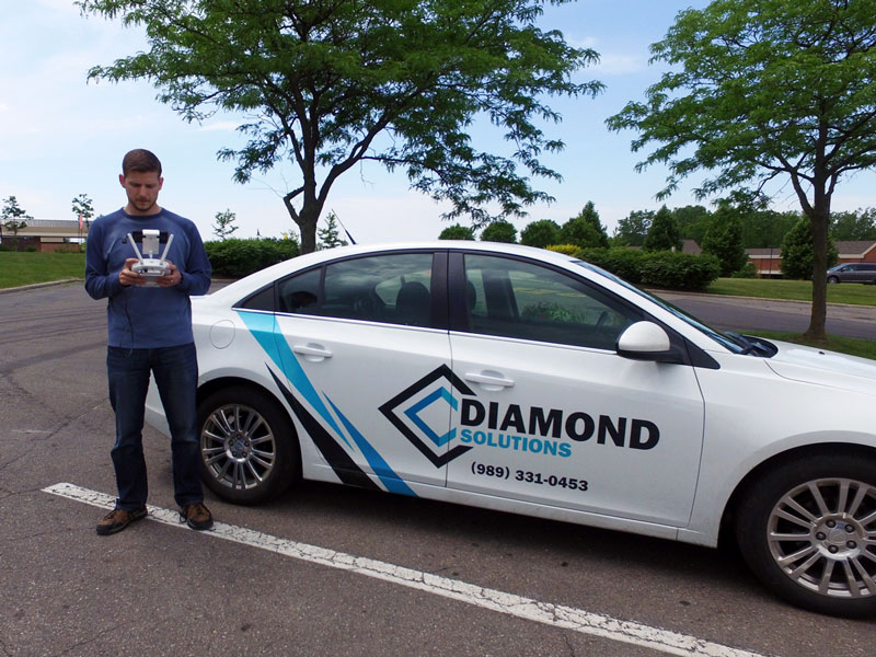 Image of a Diamond Solutions parking lot repair estimator onsite.