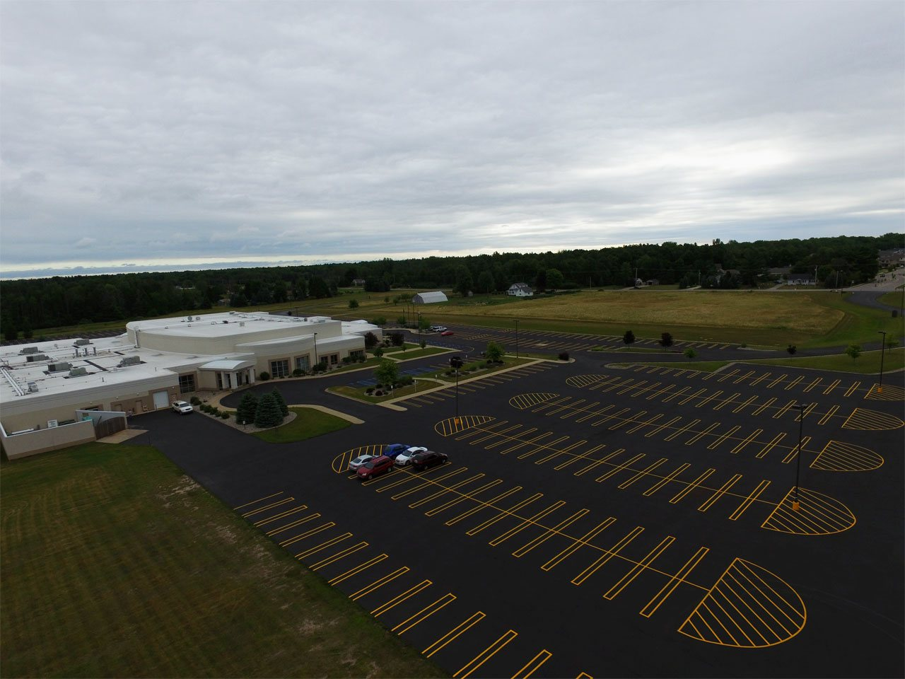 Aerial image of completely repaired, sealcoated, and striped parking lot by Diamond Solutions.