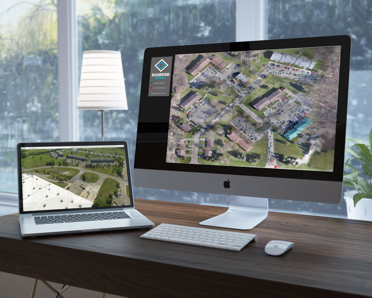 Image of Diamond repair map on an Imac and laptop, detailing parking lot repair plans.